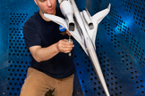 Inside Glenn's 8- by 6-Foot Supersonic Wind Tunnel, technician Dan Pitts inspects Boeing's 1.79% scale model, which shows the two installed flow-through nacelles.