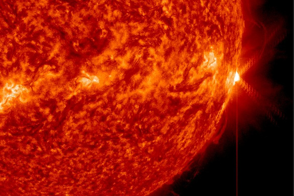 An X1.3-class solar flare (far right) erupts from the surface of the sun on April 24, 2014 EDT  (April 25 GMT).