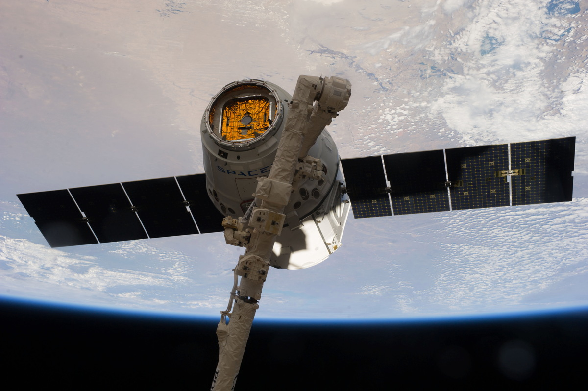 Dragon Capsule Grappled by International Space Station