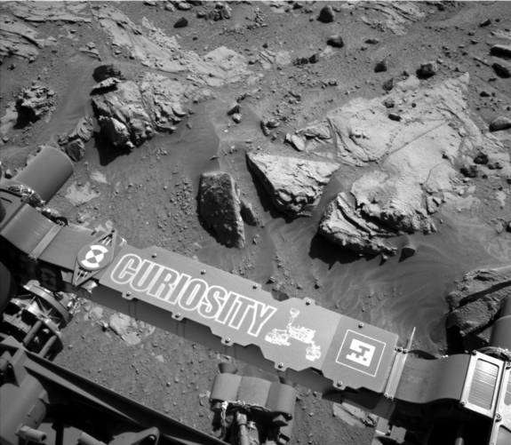 "This image from the Navigation Camera on NASA's Curiosity Mars rover shows a sandstone slab on which the rover team has selected a target, ""Windjana,"" for close-up examination. The target is on the approximately 2-foot-wide rock seen in the right half of this April 23, 2014, view."