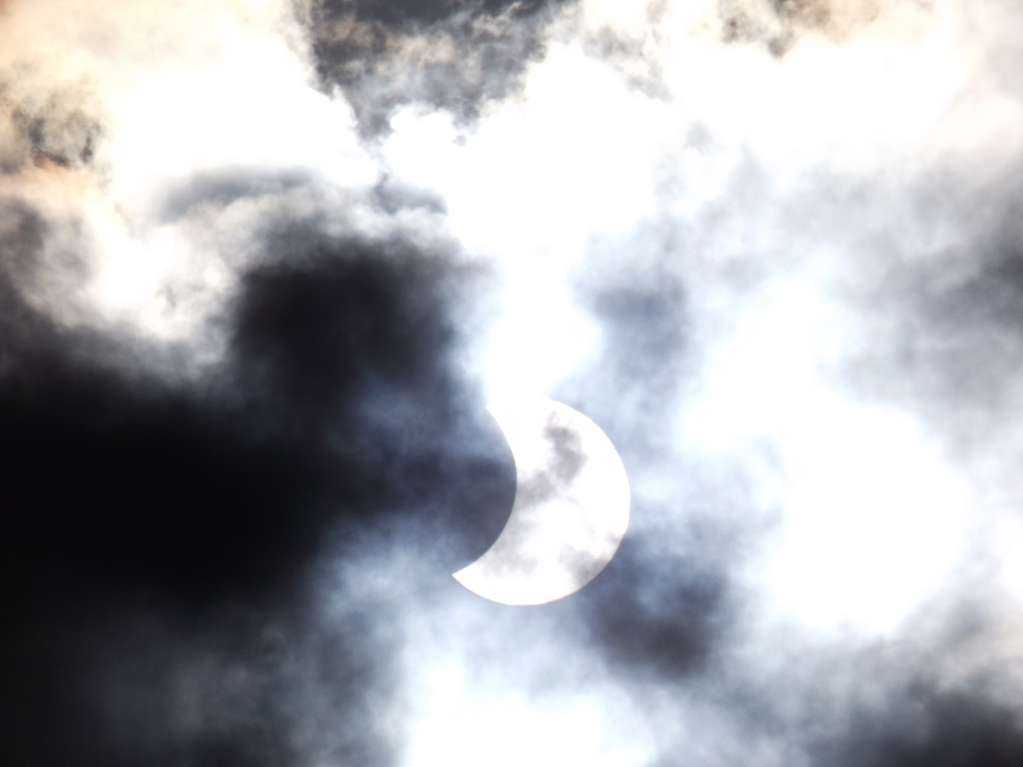 Partial Solar Eclipse and Clouds: Roxanne Whitehead