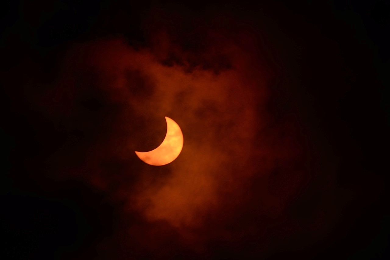 Solar Eclipse Through Clouds: Jay Pasachoff
