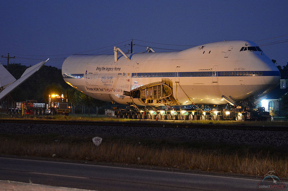 The Shuttle Carrier Aircraft arrives at the waypoint of the first leg of its two night road trip to Space Center Houston early Tuesday morning, April 29, 2014.