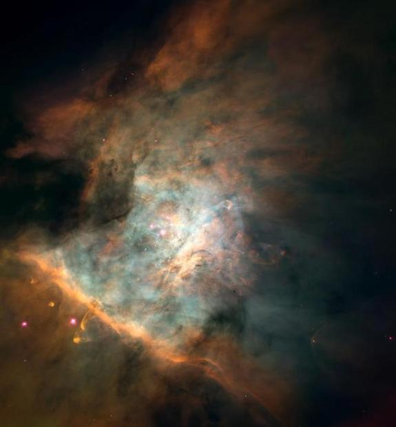 The Orion Nebula is a stellar nursery that is visible with a pair of binoculars, although Hubble Space Telescope does provide a better view.