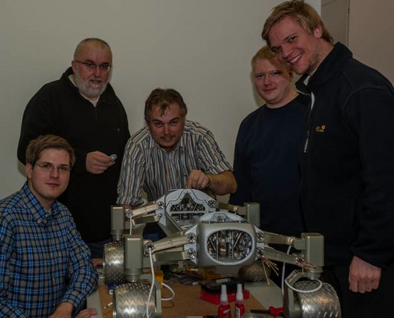 Several of the Part-Time Scientists and the rover.