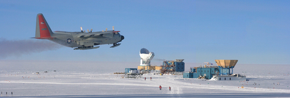 A LC-130 aircraft passes the NSF South Pole station during take off. Telescopes visible in the background include (left to right) the South Pole Telescope, the BICEP2 telescope, and the Keck Array telescope.