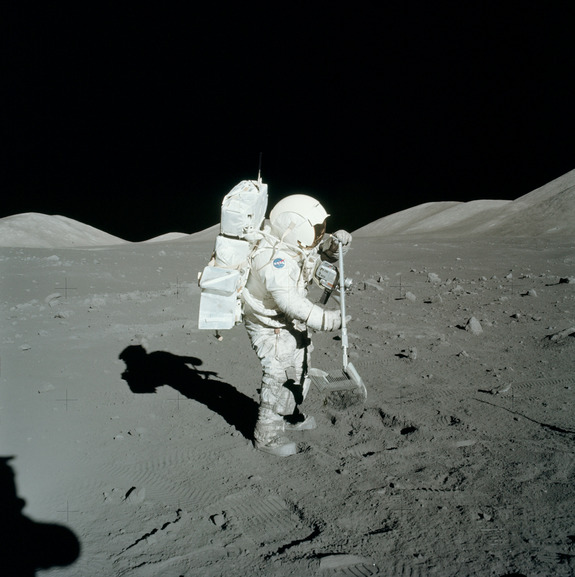 Scientist-astronaut, Jack Schmitt, rakes up regolith during the Apollo 17 expedition.