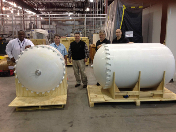 Lockheed Martin has partnered with RedEye to produce test versions of satellite fuel tanks. The project team stands with finished tank simulations.