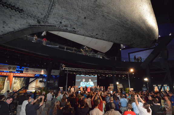 Space shuttle Atlantis appears to soar overhead during the 2014 U.S. Astronaut Hall of Fame induction ceremony honoring Shannon Lucid and Jerry Ross at  NASA's Kennedy Space Center Visitor Complex in Florida on May 3, 2014.