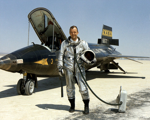 "NASA research pilot William ""Bill"" Dana is seen standing next to the X-15 rocket-powered aircraft after a flight in 1967. Dana died on May 6, 2014 at the age of 83."