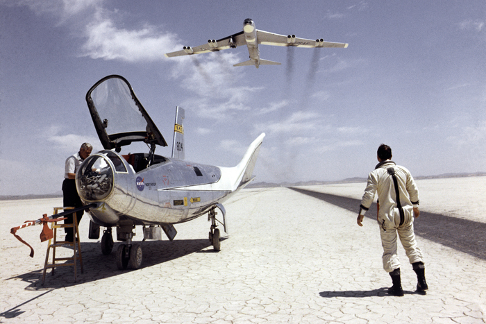 Space History Photo: HL-10 on Lakebed with B-52 Flyby