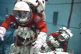 Astronauts Stan Love (left) and Steve Bowen perform a mock asteroid exploration spacewalk underwater while wearing modified versions of the orange launch and entry suits used on space shuttle missions in this still from a NASA video. The aquatic 'spacewalk' aimed to test tools and techniques for NASA's Asteroid Initiative Mission.