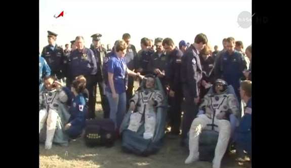 Expedition 39 astronauts Koichi Wakata, Mikhail Tyurin and Rick Mastracchio (left to right) rest after landing in a Soyuz capsule on May 13, 2014.