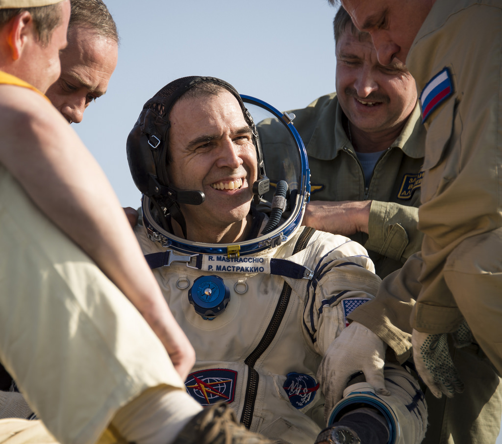 NASA astronaut Rick Mastracchio, an Expedition 39 flight engineer, smiles as he is helped out of a Soyuz TMA-11M spacecraft just minutes after returning to Earth on May 14, 2014.