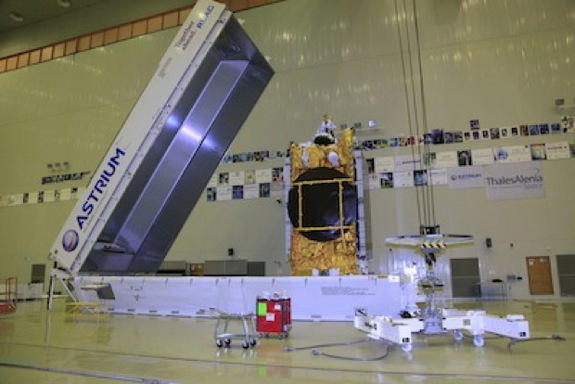 The Express AM4R spacecraft is removed from its shipping container to begin launch preparations at Baikonur.
