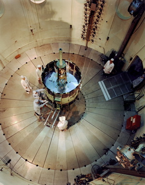 "NASA's International Sun-Earth Explorer (ISEE-3) was undergoing testing and evaluation inside Goddard's dynamic test chamber when this photo was taken. Working inside a dynamic test chamber, Goddard engineers wear protective ""clean room"" clothing to prevent microscopic dust particles from damaging the sophisticated instrumentation. NASA launched the 16-sided polyhedron, which weighed 1,032 lbs. (469 kg.), from Cape Canaveral, Florida, on August 12, 1978."
