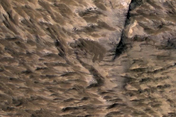 Landslides Near Fresh Crater on Mars