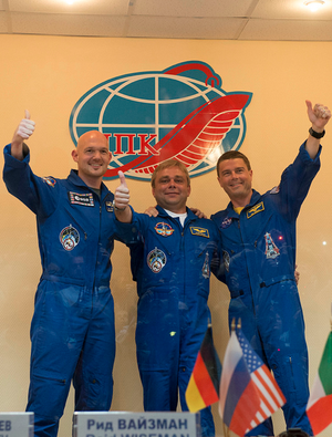 From left: ESA astronaut Alexander Gerst, Roscosmos commander Maxim Suarev, NASA astronaut Reid Wiseman pose for a photo at a press conference
