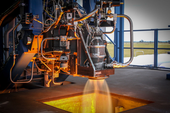 A SpaceX SuperDraco rocket thruster undergoes a test fire at the company's McGregor, Texas proving ground.