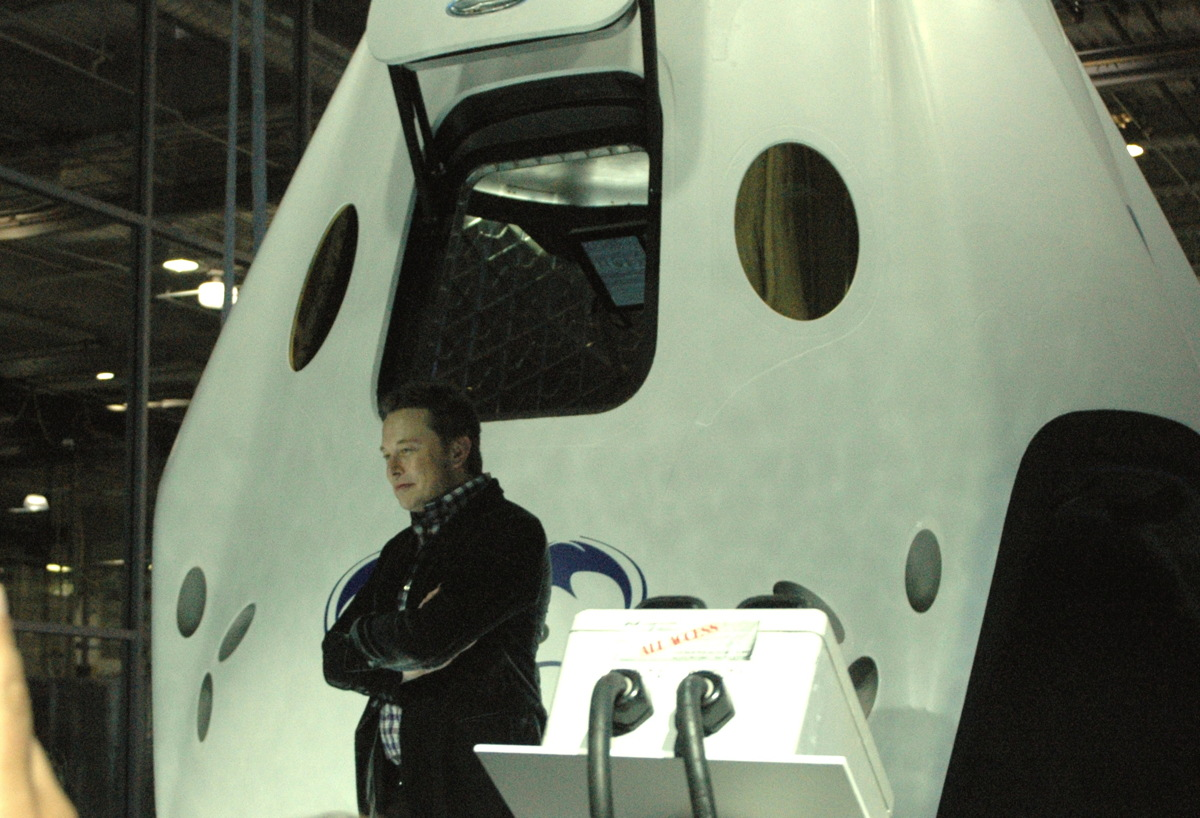 Elon Musk Poses with Dragon V2