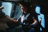 Sally Ride, America's first woman in space, looks out the forward windows of the space shuttle Challenger in June 1983.