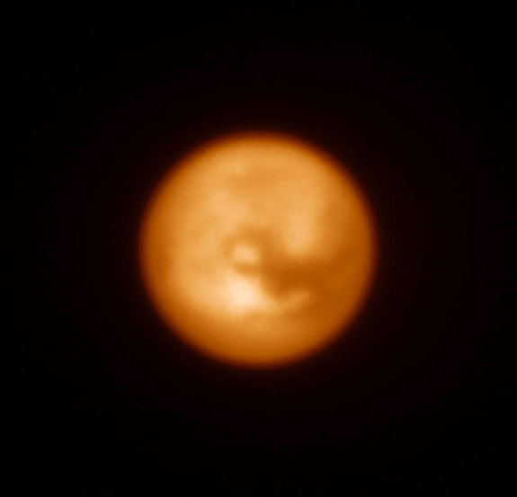 This infrared image of Saturn's largest moon, Titan, was one of the first produced by the SPHERE instrument soon after it was installed on ESO's Very Large Telescope in Chile in May 2014.