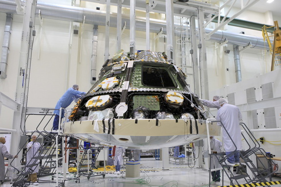 Engineers install the heat shield for NASA's Orion spacecraft. Image uploaded June 5, 2014.