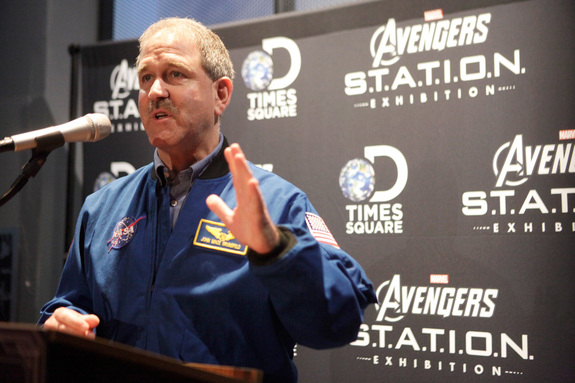 Astronaut John Grunsfeld, NASA associate administrator for science missions, speaks to guests at an opening reception for Marvel's Avengers S.T.A.T.I.O.N.