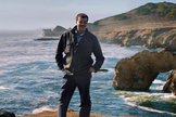 "Astrophysicist Neil deGrasse Tyson stands at the sea in a scene from ""Unafraid of the Dark,"" the final episode of ""Cosmos: A Spacetime Odyssey."""