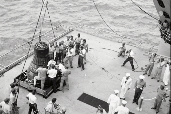 Space History Photo: Cooper and Capsule on Deck