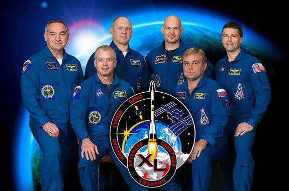 Official NASA portrait of the International Space Station's Expedition 40 crew. Left to right: Alexander Skvortsov, Steven Swanson, Oleg Artemyev, Alexander Gerst, Maxim Suraev and Reid Wiseman.