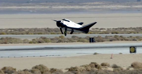 Dream Chaser space plane built by Sierra Nevada Corp. landed with its left landing gear undeployed in this still from an Oct. 26, 2013, unmanned drop test at Edwards Air Force Base in California. The malfunction caused the prototype to skid off the runway.