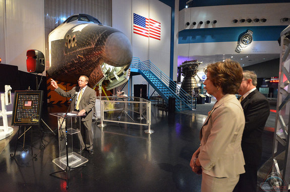 — Scott Hartwig, president and CEO of United Space Alliance (USA), speaks at his company's space shuttle pin presentation ceremony as Ellen Ochoa, NASA Johnson Space Center director, and Richard Allen, Space Center Houston president and CEO, look on, June 18, 2014