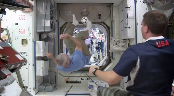 NASA astronauts Steve Swanson and Reid Wiseman and German spaceflyer Alexander Gerst show off their microgravity soccer moves in a NASA video released on June 25, 2014.