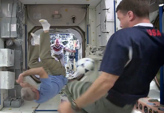 Space station astronauts play soccer in anticipation of a World Cup match between Germany and the United States on June 26, 2014.