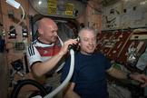 German astronaut Alexander Gerst shaves NASA astronaut Steve Swanson's head after the United States fell to Germany in a World Cup game on June 26, 2014.