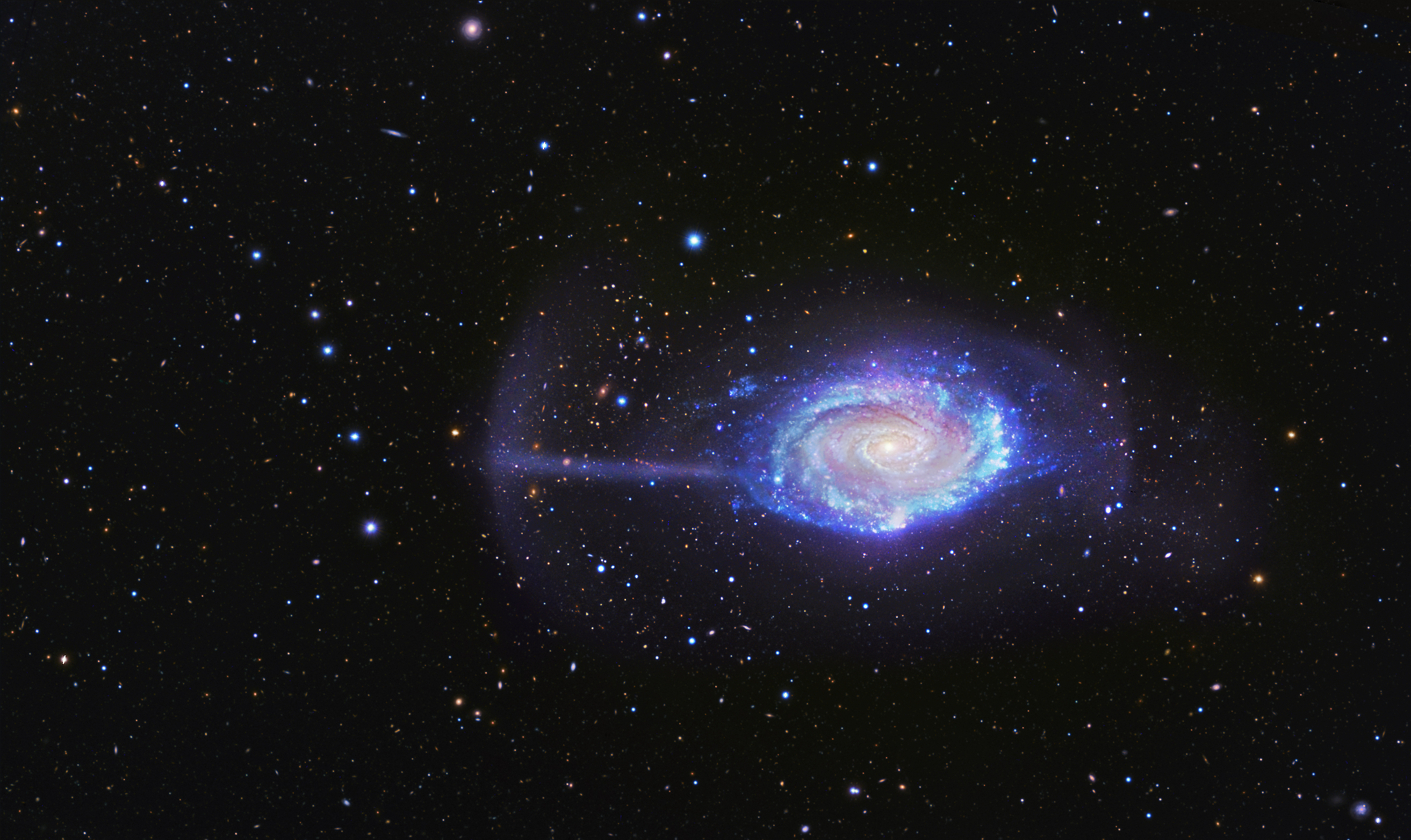 Cosmic Crumbs Reveal Umbrella Galaxy's Eating Habits