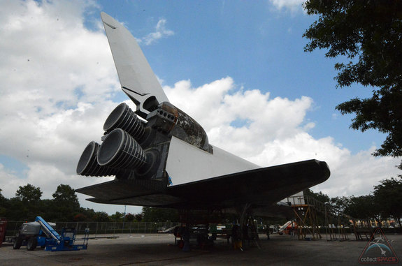 "The exterior of the replica shuttle Independence at Space Center Houston is receiving a new skin, including the replacement of the numbered heat shield tiles that line its underbody. <a href=""http://www.collectspace.com/news/news-070314b-inside-space-shuttle-independence.html"">Click here for more photos</a>."
