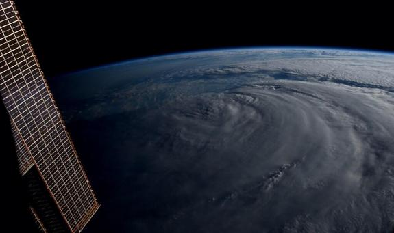 """#Neoguri has been literally cut in half. Unreal,"" wrote NASA's Reid Wiseman from the International Space Station July 8."