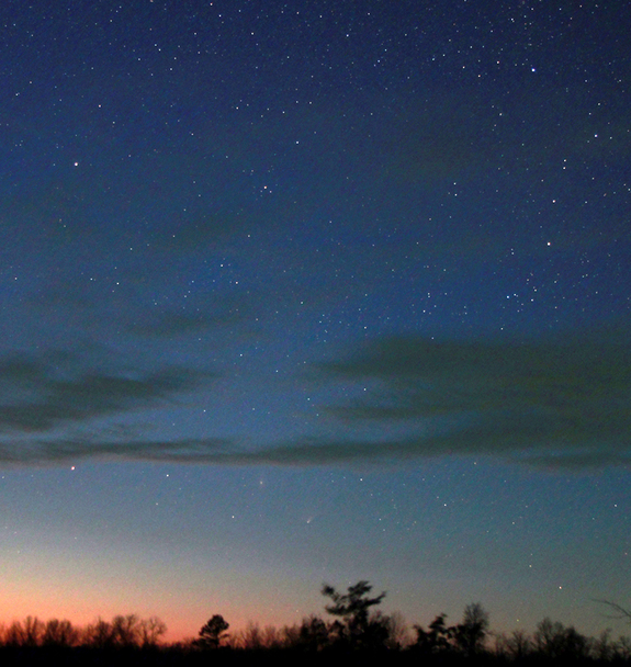 Comet Pan-STARRS in conjunction with the great Andromeda Galaxy, M31, on April 4, 2013. The objects appear just above the setting sun.