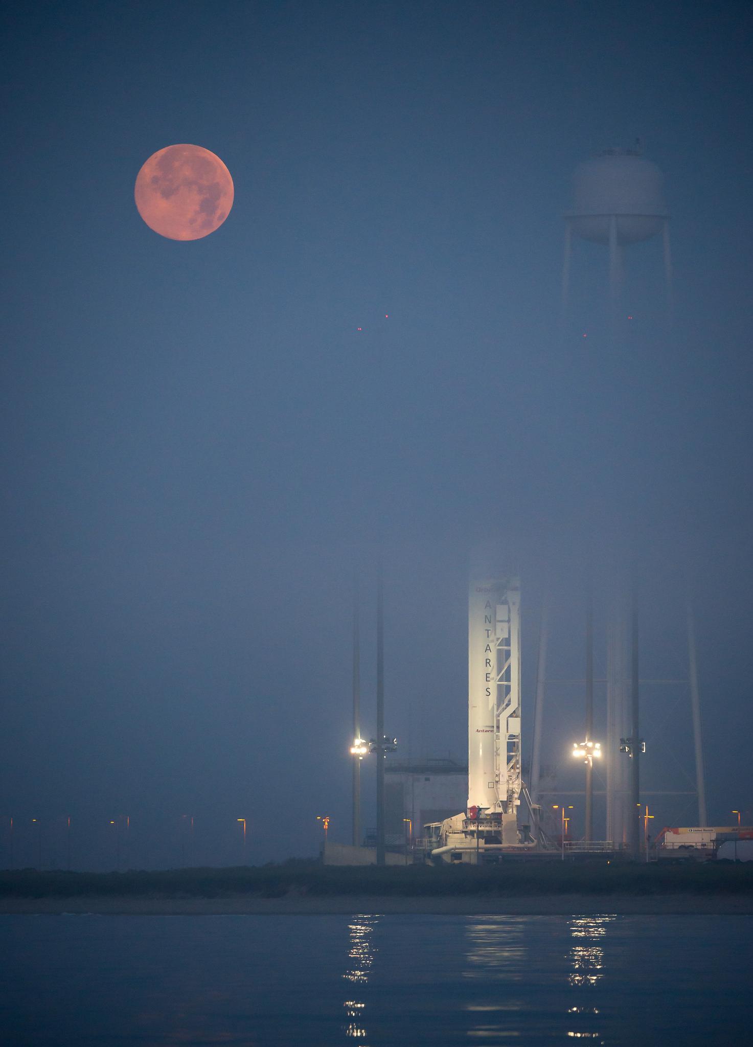 Supermoon Sets Behind Antares Rocket
