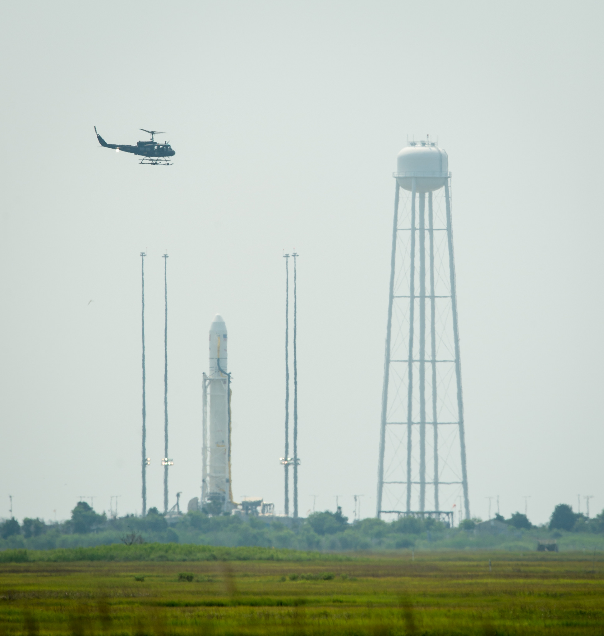 Security Helicopter Flies by Antares Rocket
