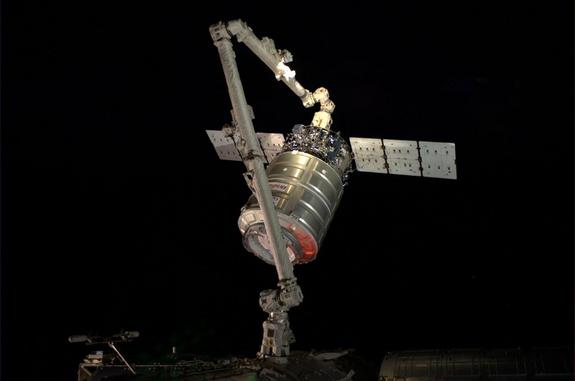 European Space Agency astronaut Alexander Gerst snapped this photo of an Orbital Sciences Corporation Cygnus spacecraft at the end of a robotic arm after the cargo ship arrived at the International Space Station on July 16, 2014.