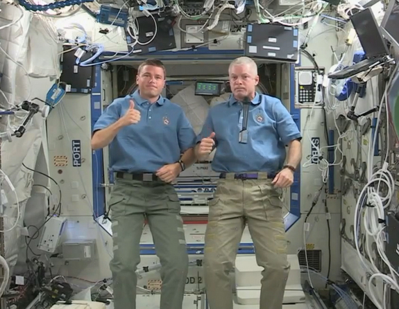 NASA astronauts Reid Wiseman (left) and Steven Swanson give a thumbs up to the Apollo 11 moon landing mission during a video marking the 45th anniversary of the epic lunar flight. Image released July 16, 2014.