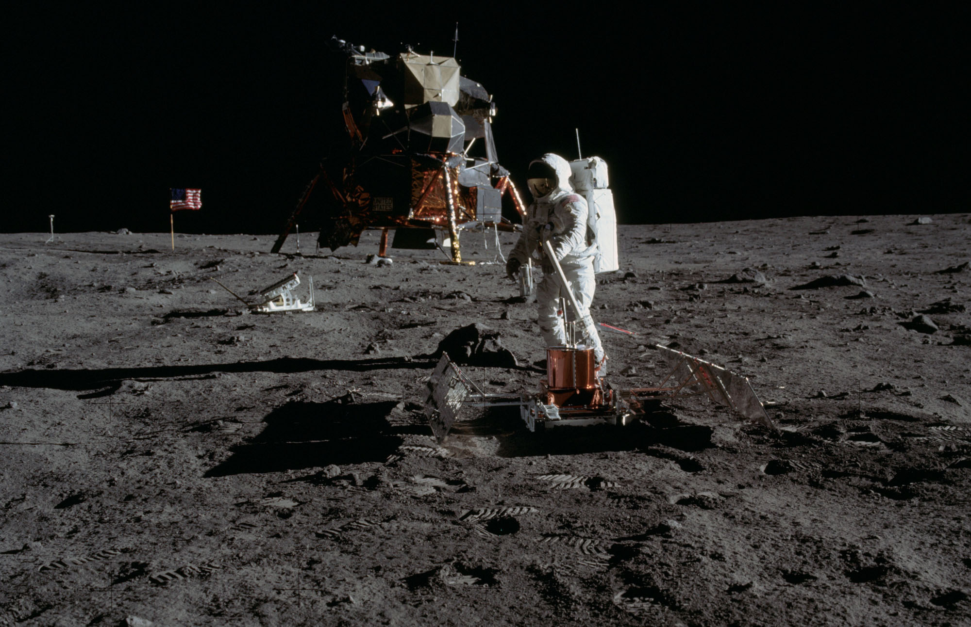 Apollo 11 astronaut Buzz Aldrin sets up the Early Apollo Scientific Experiments Package in this photo by Apollo 11 commander Neil Armstrong on July 20, 1969 after their historic moon landing.