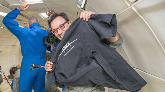Space.com managing editor Tariq Malik floats in weightlessness while shadowing the UC San Diego University Microgravity Team on a reduced gravity flight arranged by NASA.
