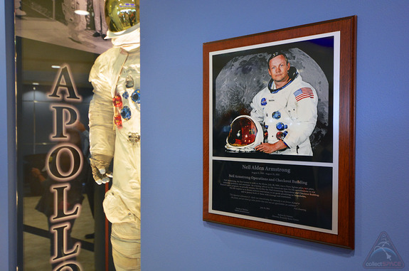 A plaque and spacesuit display have been added to the lobby of the Operations and Checkout building at NASA's Kennedy Space Center in Florida to honor the building's new namesake, Apollo 11 moonwalker Neil Armstrong.