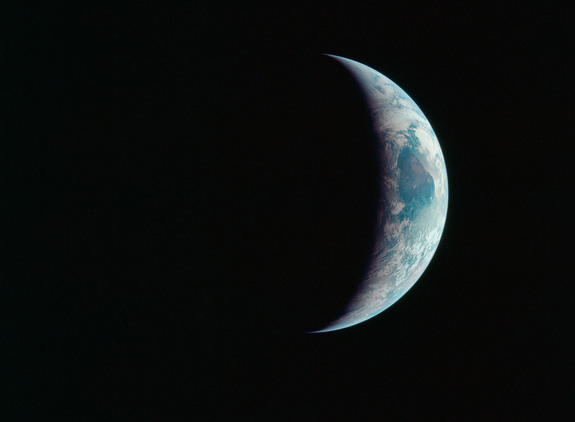 A crescent Earth hangs in the black of space in this amazing photo captured by Apollo 11 astronauts during NASA's historic first manned moon landing between July 16 and 24 in 1969.