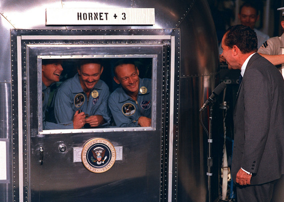 United States President Richard Nixon was in the central Pacific recovery area to welcome the Apollo 11 astronauts aboard the USS Hornet, prime recovery ship for the historic Apollo 11 lunar landing mission, on July 24, 1969. The Apollo 11 astronauts are, from left, Neil Armstrong, Michael Collins and Buzz Aldrin. They were quarantined after splashdown to ensure they did not bring back any contamination from the moon.