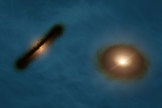 The artist's impression shows what the two stars of the HK Tauri system might look like with their skewed planetary disks.